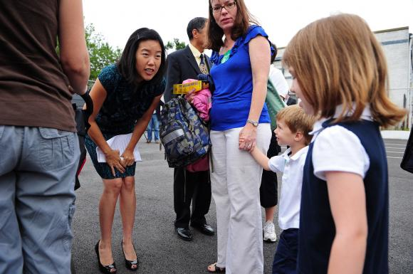 D.C. Public Schools Chancellor Michelle Rhee talks to children in Washington