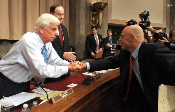 Democratic Sen. Chris Dodd and then-Treasury Secretary Hank Paulson sealing the dirty TARP deal.