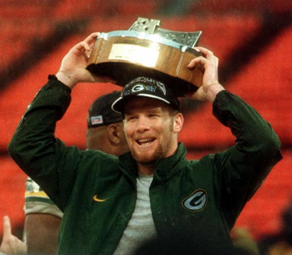 Green Bay's QB Brett Favre rests the championship trophy