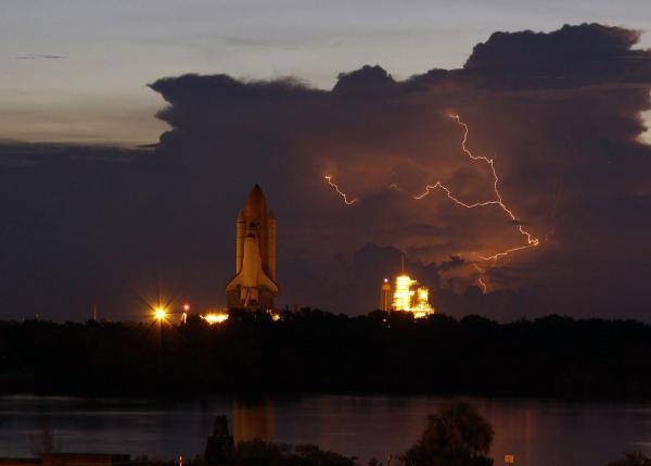 Lightning flashes during rollout of Space Shuttle Discovery in Florida