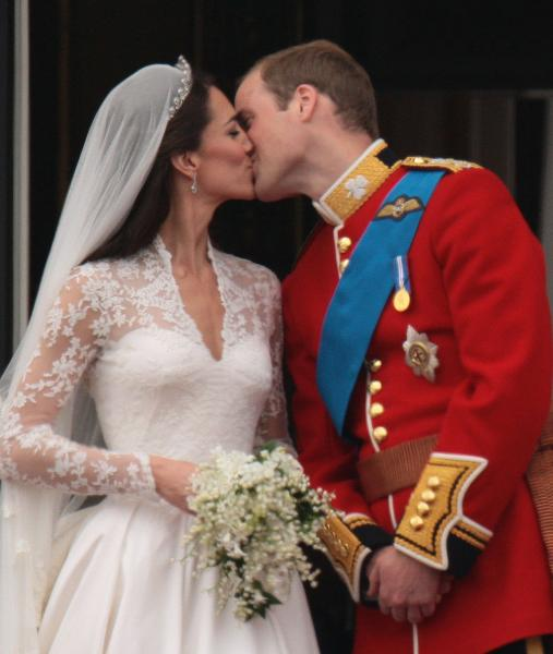 Prince William and Princess Catherine kiss after their wedding.