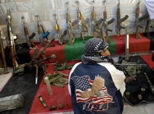 Taliban militants hand over weapons in peace-reconciliation program in Afghanistan