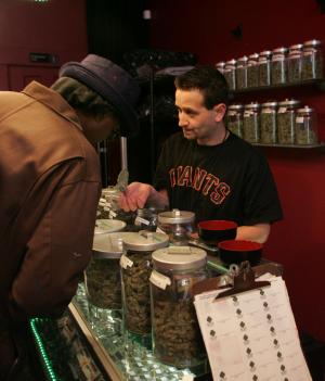 """Sativa Steve"" waits on a customer in a medicinal cannabis shop in San Francisco on June 7, 2005. People with a doctor's recommendation and a card from the California Department of Public Health can purchase from the store.The Supreme Court dealt a blow to the medical marijuana movement 6/6, ruling that the federal government can still ban possession of the drug in states.   (UPI Photo/Terry Schmitt)"