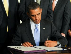 U.S. President Obama signs the Iran Sanctions Bill in Washington