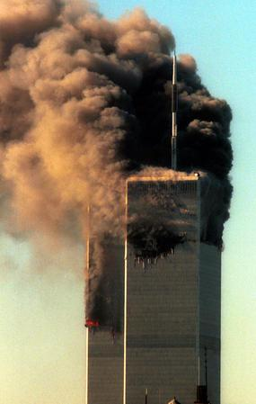 SPT11ANN24 - WASHINGTON, Aug. 19 (UPI) - FILE PHOTO - Sept. 11, 2001 -  he twin towers of the World Trade Center billow smoke after two airplanes crashed into the towers around 9am September 11, 2001, in New York.    rlw/Laura Cavanaugh    UPI