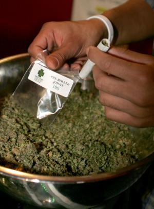 "An employee prepares a ""joint"" for sale in a medicinal cannabis shop in San Francisco on June 7, 2005. People with a doctor's recommendation and a card from the California Department of Public Health can purchase from the store.The Supreme Court dealt a blow to the medical marijuana movement 6/6, ruling that the federal government can still ban possession of the drug in states.   (UPI Photo/Terry Schmitt)"