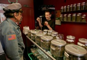 """Sativa Steve"" (R)  works the counter in a medicinal cannabis shop in San Francisco on June 7, 2005. People with a doctor's recommendation and a card from the California Department of Public Health can purchase from the store.The Supreme Court dealt a blow to the medical marijuana movement 6/6, ruling that the federal government can still ban possession of the drug in states.   (UPI Photo/Terry Schmitt)"