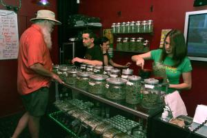 """Sativa Steve"" assists a customer as Rachel as Rachel weighs a purchase in a medicinal cannabis shop in San Francisco on June 7, 2005. People with a doctor's recommendation and card from the California Department of Public Health can purchase from the store. The Supreme Court dealt a blow to the medical marijuana movement 6/6, ruling that the federal government can still ban possession of the drug in states.   (UPI Photo/Terry Schmitt)"