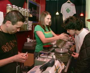 Sativa Steve (L)  handles a transaction while Rachel gives a smell to a customer in a medicinal cannabis shop in San Francisco on June 7, 2005. People with a doctor's recommendation and a card from the California Department of Public Health can purchase from the store.The Supreme Court dealt a blow to the medical marijuana movement 6/6, ruling that the federal government can still ban possession of the drug in states.   (UPI Photo/Terry Schmitt)