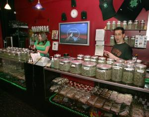 Sativa Steve (R) and Rachel work the counter in a medicinal cannabis shop in San Francisco on June 7, 2005.People with a doctor's recommendation and a card from the California Department of Public Health can purchase from the store. The Supreme Court dealt a blow to the medical marijuana movement 6/6, ruling that the federal government can still ban possession of the drug in states.   (UPI Photo/Terry Schmitt)