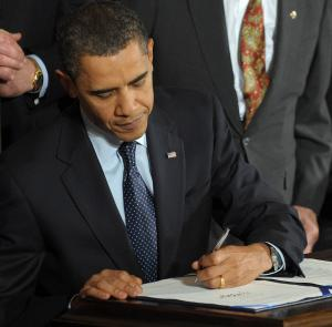 Picture of Obama Signing Health Care bill