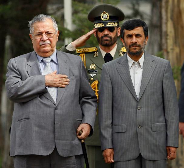 Iraq's President Jalal Talabani (L) and Iran's President Mahmoud Ahmadinejad (R) listen to the national anthems of their countries during a welcoming ceremony for Talabani before their meeting in Tehran, Iran on February 27, 2009. (UPI Photo/Hossein Fatemi/Fars News Agency) ..