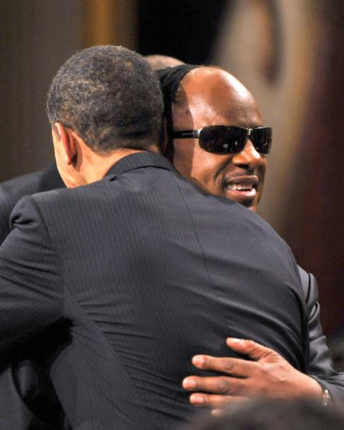 United States President Barack Obama hugs Stevie Wonder uring special event hosted by the Obamas in honor of musician Stevie Wonder's receipt of the Library of Congress Gershwin Prize for Popular Song in the East Room of the White House in Washington on Wednesday, February 25, 2009.  (UPI Photo/Ron Sachs/Pool)