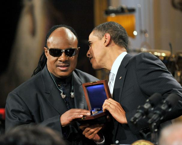 United States President Barack Obama shakes hands with Stevie Wonder as he and first lady Michelle Obama host a special event in honor of musician Stevie Wonder's receipt of the Library of Congress Gershwin Prize for Popular Song in the East Room of the White House in Washington on Wednesday, February 25, 2009.  (UPI Photo/Ron Sachs/Pool)
